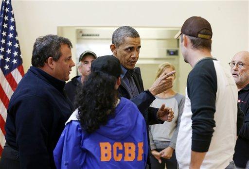 President Barack Obama, accompanied by New Jersey Gov. Chris Christie meets with local residents at the Brigantine Beach Community Center in Brigantine, NJ., Wednesday, Oct. 31, 2012. (AP Photo/Pablo Martinez Monsivais)
