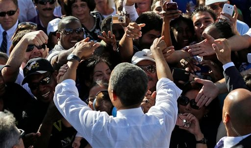 President Barack Obama greets supporters at a campaign event at Cheyenne Sports Complex in Las Vegas, Thursday, Nov. 1, 2012. (AP Photo/Pablo Martinez Monsivais)