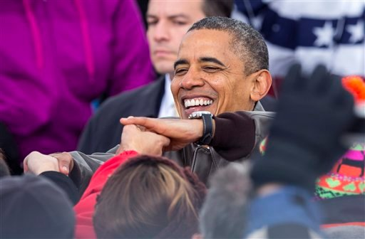 President Barack Obama shakes hands with supporters during a campaign stop at Austin Straubel International Airport in Green Bay, Wis.,Thursday, Nov. 1, 2012. (AP Photo/Tom Lynn)