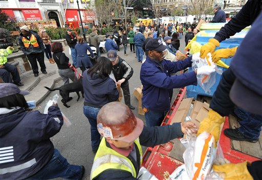 Dry ice is unloaded from a flatbed truck in Union Square for distribution to residents of the still powerless Chelsea section of Manhattan, Thursday, Nov.1, 2012, in New York. (AP Photo/ Louis Lanzano)