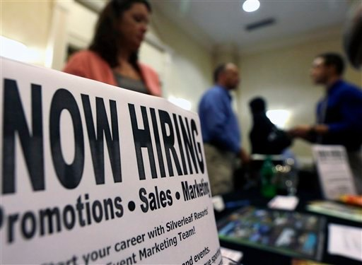 © In this Thursday, Oct. 25, 2012, photo, a sign attracts job-seekers during a job fair at the Marriott Hotel in Colonie, N.Y. According to government reports released Friday, Nov. 2, 2012, the U.S. economy added 171,000 jobs in October.