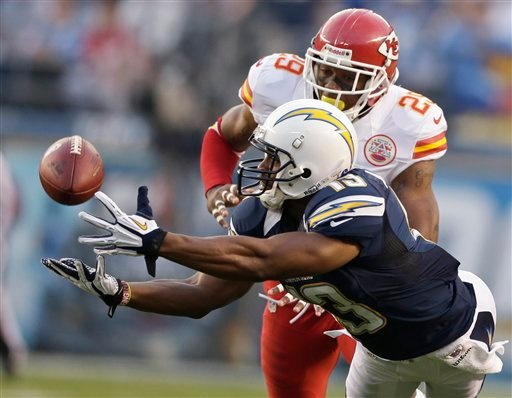 © San Diego Chargers receiver Seyi Ajirotutu makes a diving catch in front of Kansas City Chiefs strong safety Eric Berry during the first half of an NFL football game Thursday, Nov. 1, 2012, in San Diego.