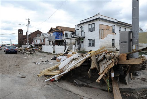  Debris and destroyed homes line streets in Long Beach, N.Y. Thursday, Nov. 1, 2012. Three days after Sandy slammed the mid-Atlantic and the Northeast, New York and New Jersey struggled to get back on their feet, the U.S. death toll climbed to 90.