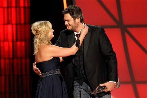 """© Miranda Lambert, left, and Blake Shelton embrace onstage after winning the award for song of the year for """"Over You"""" at the 46th Annual Country Music Awards at the Bridgestone Arena on Thursday, Nov. 1, 2012, in Nashville, Tenn."""