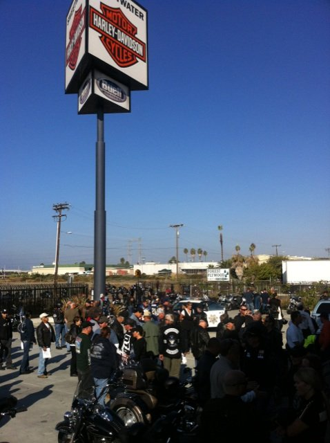 © Large crowd gathers outside Sweetwater Harley-Davidson in National City Saturday for a fundraising ride benefiting detective Ali Perez.