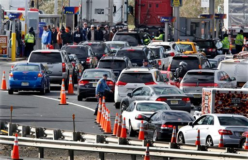 © New Jersey state troopers keep order as motorists line up to purchase gasoline at the Thomas A. Edison service area on the New Jersey Turnpike, Saturday, Nov. 3, 2012, near Woodbridge, N.J.