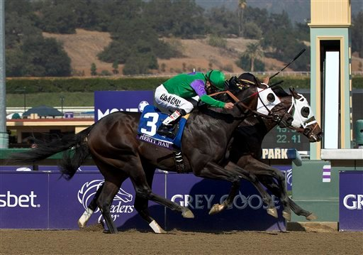 © Hightail, rear right, ridden by Rajiv Maragh noses ahead of Merit Man (3), ridden by Patrick Valenzuela, at the wire to win the Juvenile Sprint horse race at the Breeders' Cup, Friday, Nov. 2, 2012, in Arcadia, Calif.
