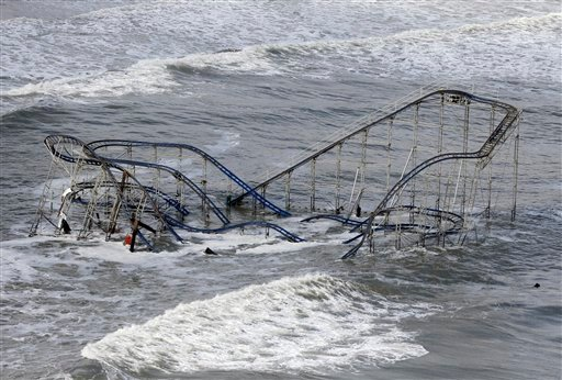 © In this Wednesday, Oct. 31, 2012 file photo, waves wash over a roller coaster from a Seaside Heights, N.J., amusement park that fell in the Atlantic Ocean during Superstorm Sandy.