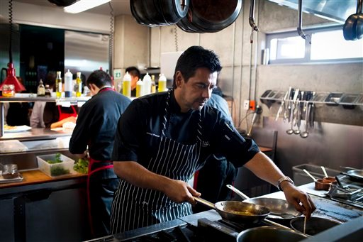 © In this Sept. 27, 2012 photo, Chef Javier Plascencia cooks in the kitchen at Mission 19 restaurant in Tijuana, Mexico.