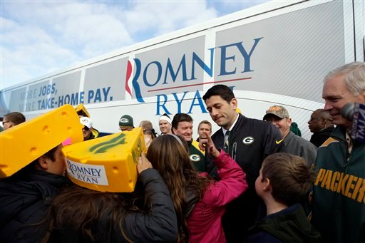 © Republican vice presidential candidate, Rep. Paul Ryan, R-Wis., talks to his daughter Liza at a tailgate party for the football game between the Green Bay Packers and the Arizona Cardinals at Lambeau Field, Sunday, Nov. 4, 2012 in Green Bay , Wis.