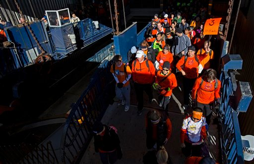 © Runners board the Staten Island Ferry in New York, Sunday, Nov. 4, 2012. With the cancellation of the New York Marathon, hundreds of runners, wearing their marathon shirts and backpacks full of supplies.