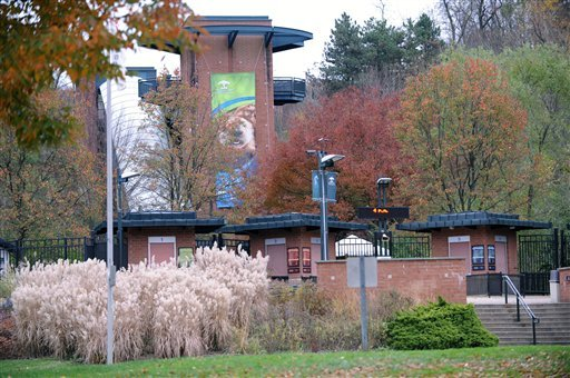 © This photo taken Sunday, Nov. 4, 2012 shows the exterior view of the front entrance of the Pittsburgh Zoo, where zoo officials say a young boy was killed after he fell into the exhibit that was home to a pack of African painted dogs.