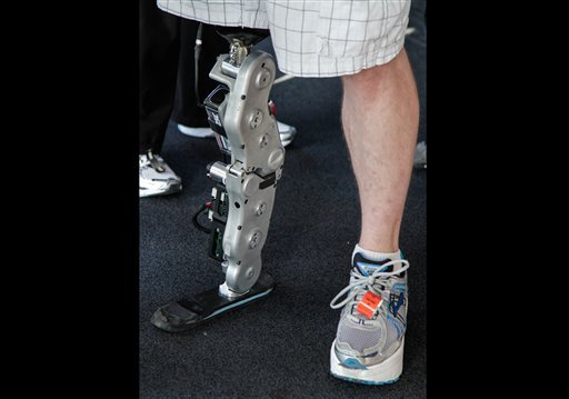 © Zac Vawter's stands on his bionic leg after he arriving on the 103rd floor of Willis Tower, becoming the first person ever to complete the task wearing the mind-controlled prosthetic limb, Sunday, Nov. 4, 2012 in Chicago.