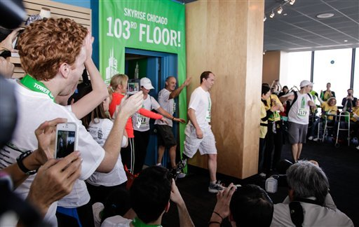 © Zac Vawter arrives on the 103rd floor of Willis Tower, becoming the first person ever to complete the task wearing a mind-controlled prosthetic limb, Sunday, Nov. 4, 2012 in Chicago.