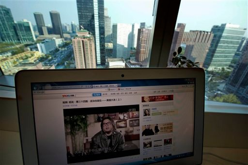 © Chinese pop musician Gao Xiaosong, shown on a computer screen in Beijing, China, Monday, Nov. 5, 2012, speaks in his online talk show posted on the popular video-sharing site Youku.com.