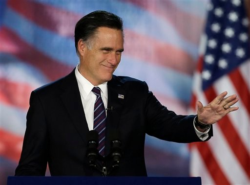 © Republican presidential candidate and former Massachusetts Gov. Mitt Romney greets supporters at a New Hampshire campaign rally at Verizon Wireless Arena in Manchester, N.H., Monday, Nov. 5, 2012.
