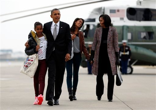 President Barack Obama, first lady Michelle Obama and their daughters Sasha and Malia, walk from Marine One to board Air Force One at Chicago O'Hare International Airport, Wednesday, Nov. 7, 2012, in Chicago, the day after the presidential election. (AP)