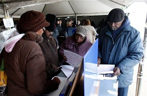 © Voters fill out affidavit ballots under a tent at a consolidated polling station for residents of the Rockaways on Election Day, Tuesday, Nov. 6, 2012, in the Queens borough of New York.
