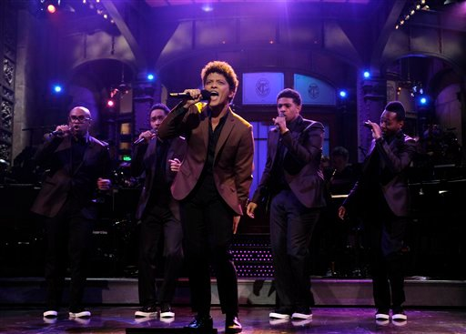 "© This Oct. 20, 2012 photo released by NBC shows guest host Bruno Mars performing on ""Saturday Night Live,"" in New York. Mars' recent appearance on ""Saturday Night Live"" was more like Saturday Night Fever: He says he had so much fun hosting the show."