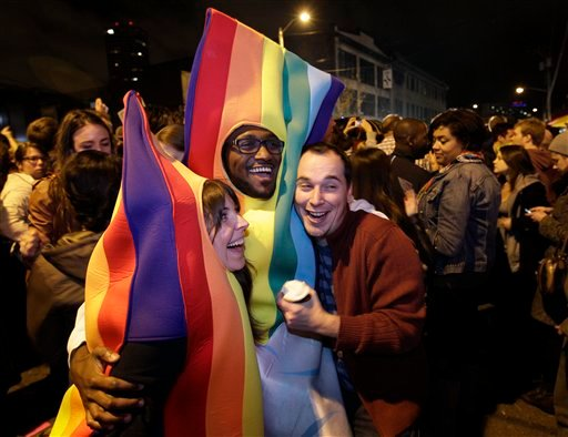 People celebrate early election returns favoring Washington state Referendum 74, which would legalize gay marriage, during a large impromptu street gathering in Seattle's Capitol Hill neighborhood Nov. 6, 2012. (AP Photo/Ted S. Warren)