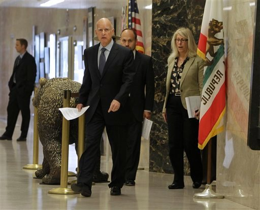 Gov. Jerry Brown leaves his office to attend a news conference where he discussed the passage of his tax initiative, Proposition 30, in Sacramento, Calif., Wednesday, Nov. 7, 2012. (AP Photo/Rich Pedroncelli)