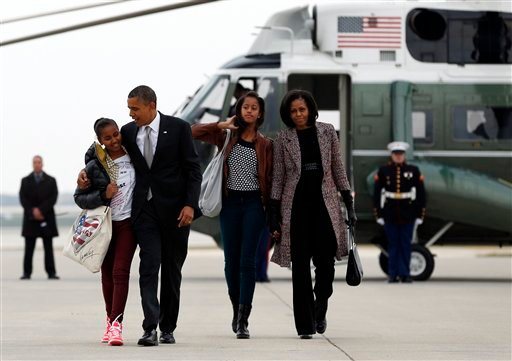 President Barack Obama, first lady Michelle Obama and Sasha, left, and Malia, walk from Marine One to board Air Force One at Chicago O'Hare International Airport Nov. 7, 2012, in Chicago, the day after the presidential election. (AP Photo/Carolyn Kaster)