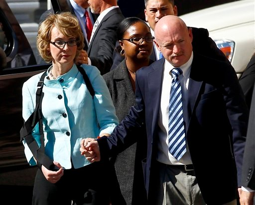Former Democratic Rep. Gabrielle Giffords, left, and her husband Mark Kelly leave after the sentencing of Jared Loughner, in back of U.S. District Court Thursday, Nov. 8, 2012, in Tucson, Ariz. (AP Photo/Ross D. Franklin)