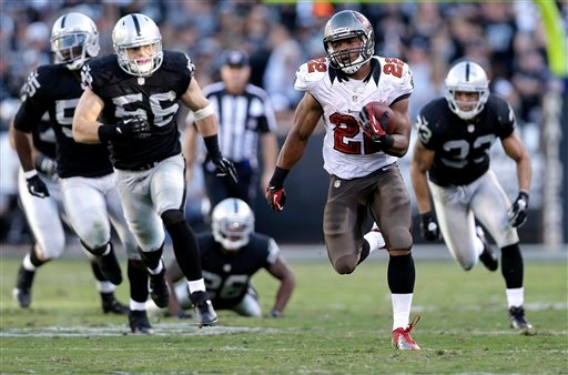 Tampa Bay Buccaneers running back Doug Martin (22) runs for a 67-yard touchdown against the Oakland Raiders during the third quarter of an NFL football game in Oakland, Calif., Sunday, Nov. 4, 2012. (AP Photo/Marcio Jose Sanchez)