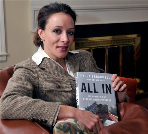 "© In this Jan. 15, 2012 photo, Paula Broadwell, author of the David Petraeus biography ""All In,"" poses for photos in Charlotte, N.C."