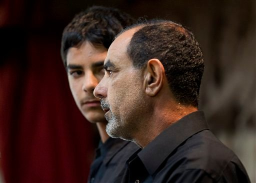 FILE - In this March 27,2012 file photo showing Kassim Alhimidi, right, speaks alongside his son, Mohammed Alhimidi, during a memorial for his wife, Shaima Alawadi at a mosque in Lakeside, Calif. (AP Photo/Gregory Bull,File)