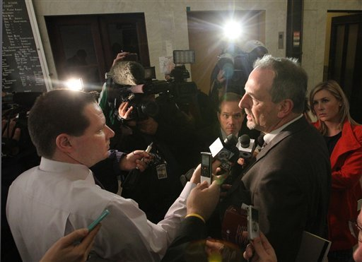 Summit County Assistant Prosecutor Jon Baumoel, right, is interviewed by members of the media after Brogan Rafferty was sentenced on Friday, Nov. 9, 2012 in Akron, Ohio. (AP Photo/Akron Beacon Journal, Phil Masturzo, Pool)
