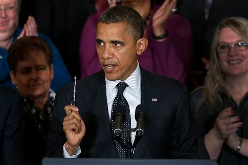 © President Barack Obama holds up a pen as he speaks about the economy and the deficit, Friday, Nov. 9, 2012, in the East Room of the White House in Washington. (AP Photo/Carolyn Kaster)
