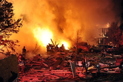 © Firefighters work the scene where an explosion has killed two people and damaged more than a dozen homes in the Richmond Hill subdivision, late Saturday, Nov. 10, 2012, in Indianapolis.