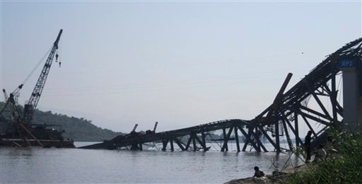 © A bridge under construction across the Irrawaddy River, east of Shwebo, Myanmar is seen collapsed after a strong earthquake on Sunday, Nov. 11, 2012. The magnitude-6.8 quake struck northern Myanmar on Sunday, collapsing the bridge and a gold mine.