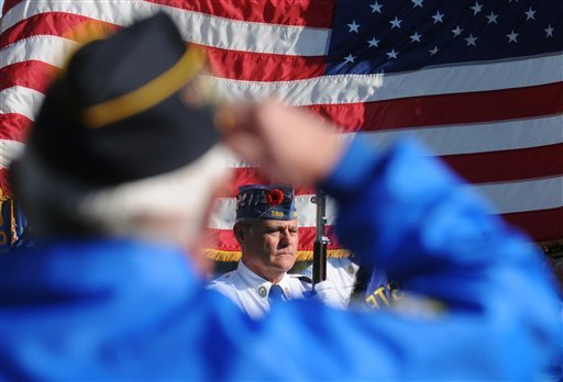 © Mike Hoover, pictured, with American Legion Post 568, in Stevensville, Mich., stands at attention Sunday, November 11, 2012, during a Veterans Day Salute held at the Lincoln Township Cemetery, in Stevensville, Mich.