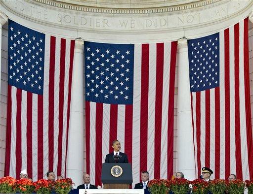 © President Barack Obama speaks during a Veterans Day ceremony at the Arlington National Cemetery Amphitheater in Arlington, Va., Sunday, Nov. 11, 2012. (AP Photo/J. Scott Applewhite)