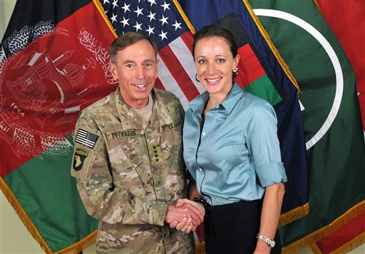 July 13, 2011 photo made available on the International Security Assistance Force's Flickr website: former Commander of International Security Assistance Force and U.S. Forces-Afghanistan Gen. Petraeus shaking hands with Paula Broadwell. (AP Photo/ISAF)
