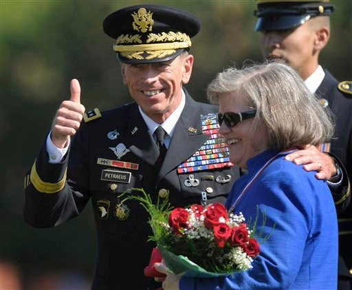 Aug. 31, 2011 file photo: former Commander of International Security Assistance Force and U.S. Forces-Afghanistan Gen. Davis Petraeus, standing with his wife Holly. (AP Photo/Susan Walsh, File)