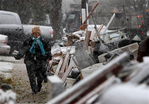 Nov. 7, 2012, file photo: a woman, who wanted to remain anonymous, returns home from work in the snow to her house in the New Dorp section of Staten Island, New York. (AP Photo/Seth Wenig, File)