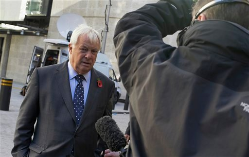 Chris Patten, Chairman of the BBC Trust prepares to give a media interview outside the headquarters of the BBC in London, Sunday, Nov. 11, 2012. (AP Photo/Alastair Grant)