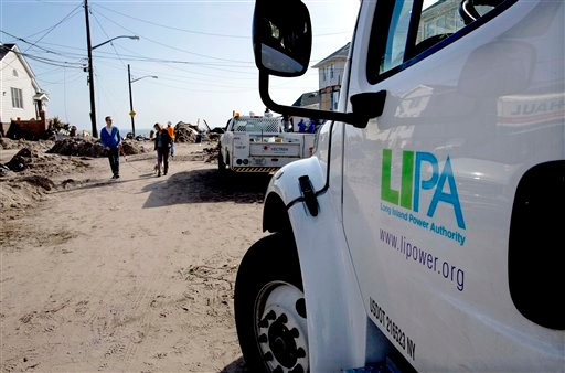 A Long Island Power Authority (LIPA) truck is seen in the Belle Harbor neighborhood of the borough of Queens, New York, Monday, Nov.12, 2012, in the wake of Superstorm Sandy. (AP Photo/Craig Ruttle)