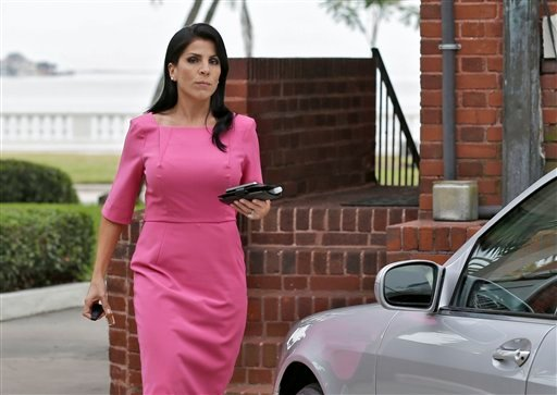 Jill Kelley leaves her home Tuesday, Nov 13, 2012 in Tampa, Fla. Kelley is identified as the woman who allegedly received harassing emails from Gen. David Petraeus' paramour, Paula Broadwell. (AP Photo/Chris O'Meara)