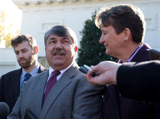 AFL-CIO President Richard Trumka, center, by Justin Ruben, executive director of MoveOn.org, left, and Mary Kay Henry, International President of the Service Employees International Union, speaks to reporters Nov. 13, 2012. (AP Photo/Carolyn Kaster)