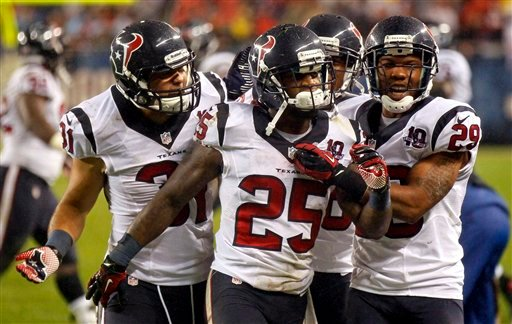 Houston Texans cornerback Kareem Jackson (25) celebrates his interception against the Chicago Bears with teammates Shiloh Keo (31) and Glover Quin (29) during the first half an NFL football game, Sunday, Nov. 11, 2012, in Chicago. (AP Photo)