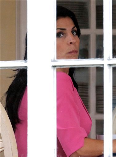 Jill Kelley looks out the window of her home Tuesday, Nov 12, 2012 in Tampa, Fla. (AP Photo/Chris O'Meara)