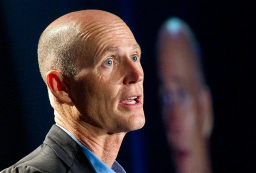 FILE - In this May 16, 2012 file photo, Florida Gov. Rick Scott speaks in Fort Lauderdale, Fla. From the South to the heartland, cracks are appearing in the once-solid wall of Republican resistance to President Barack Obama's health care law. (AP Photo)