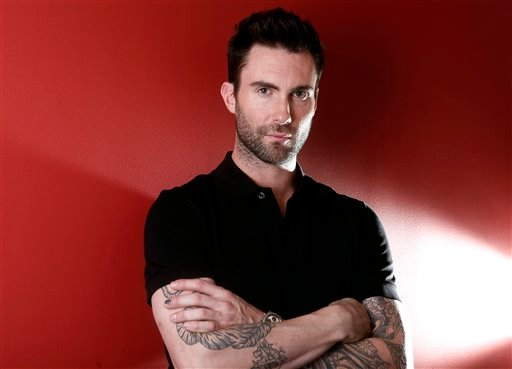 FILE - This Feb. 20, 2012 file photo shows Maroon 5 frontman Adam Levine in New York. (AP Photo/Carlo Allegri, file)