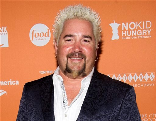 This Oct. 11, 2012 file photo shows chef Guy Fieri at the &quot;On The Chopping Block: A Roast of Anthony Bourdain&quot; in New York. (Photo by Charles Sykes/Invision/AP)