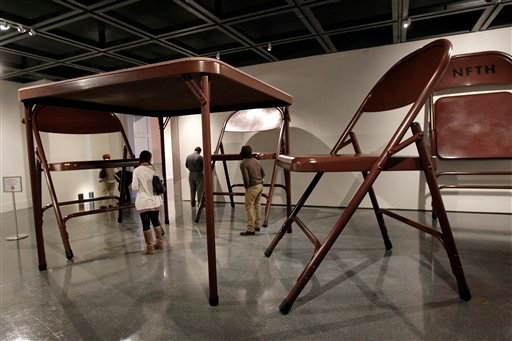 © In this Wednesday, Nov. 14, 2012 photo, giant folding tables and chairs are part of the untitled installation by artist Robert Therrien on display at the New Orleans Museum of Art, in New Orleans, Wednesday, Nov. 14, 2012.