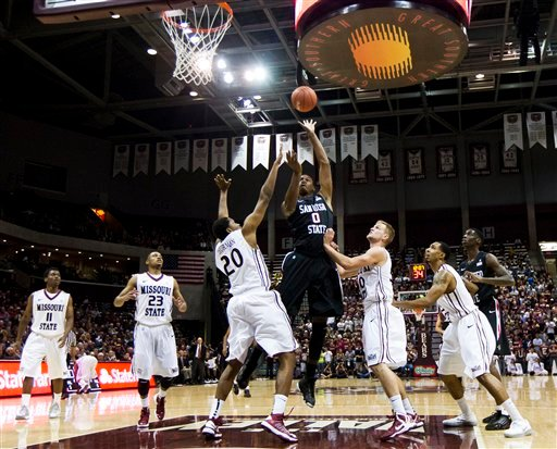 © San Diego State forward Skylar Spencer, center, shoots against Missouri State during the first half of an NCAA college basketball game Saturday, Nov. 17, 2012, in Springfield, Mo.